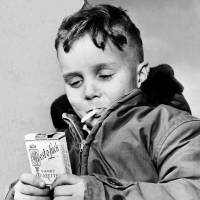 Habit-forming: A 5-year-old in Fargo, North Dakota, holds candy cigarettes in March 1953, the year the state banned the sale of candy packaged to resemble cigarettes. | AP