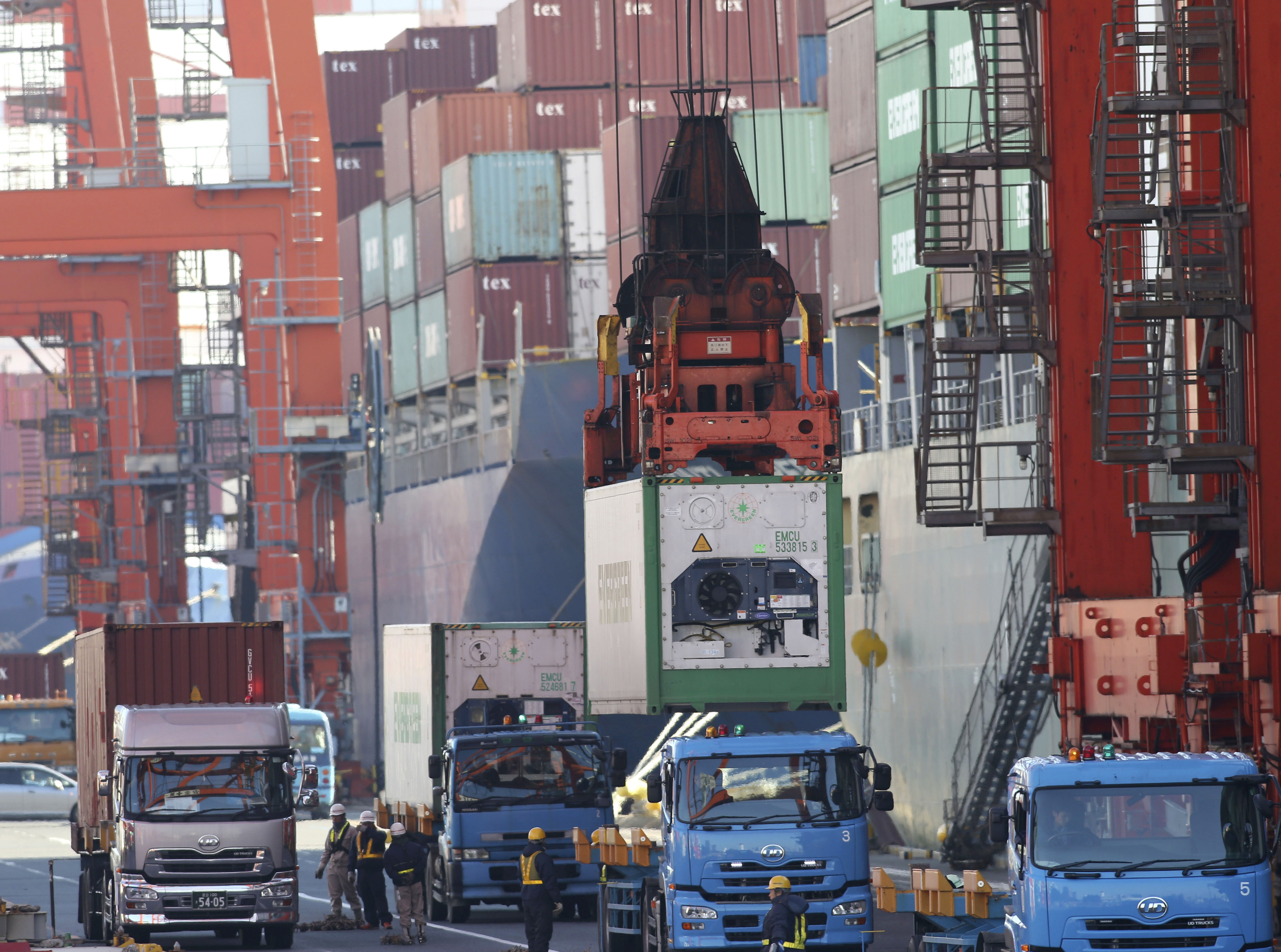 1 chris 2erTrading places: A container is lifted from a truck ahead of being loaded onto a freighter Monday in Tokyo. Japan's trade deficit surged to a record ¥11.47 trillion in 2013 after the shutdown of nuclear power plants swelled the nation's energy import bill. | AP
