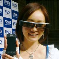 Vision of the future: A model wears Moverio BT-200 smart glasses on Tuesday. Seiko Epson Corp. will launch the glasses, which allow users to watch movies and browse the Internet, on April 24. | KYODO