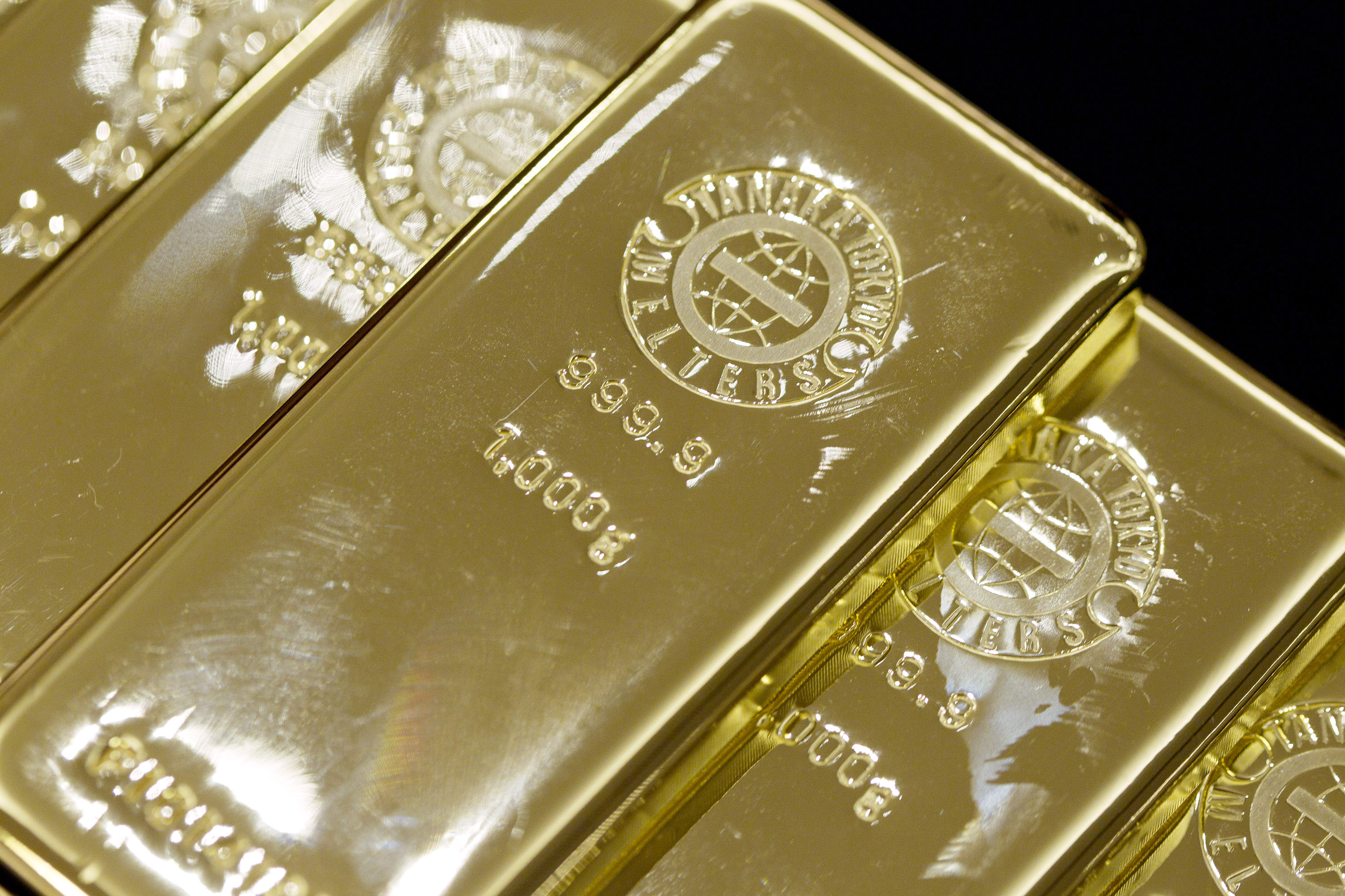 All that glitter: Gold bars are displayed at the Tanaka Kikinzoku Jewelry store in Tokyo on July 10.   BLOOMBERG