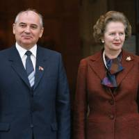 Knock-knock: Future Soviet leader Mikhail Gorbachev poses with British Prime Minister Margaret Thatcher at the prime minister's official country residence of Chequers, north of London, on Dec. 16, 1984. | AP