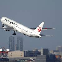 Gear up: A Japan Airlines Co. jetliner takes off from Tokyo's Haneda airport on Oct. 27. JAL said Thursday it will launch new direct flights between Tokyo and London and increase other flights from Haneda using allocated new slots.   BLOOMBERG
