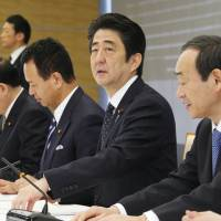 Good news: Prime Minister Shinzo Abe starts the Cabinet meeting on the monthly economic report Friday. | KYODO
