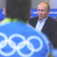 Words of encouragement: Russian President Vladimir Putin speaks during a meeting with Olympic volunteers in the Black Sea resort of Sochi on Friday. | AP
