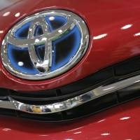 Selling briskly: A Toyota badge shines at Toyota Motor Corp.'s showroom in Tokyo last August. | BLOOMBERG