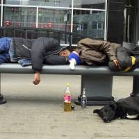 Proof negative: Two men sleep it off in downtown Moscow. Russian men who down large amounts of vodka, or at least three half-liter bottles per week, have an 'extraordinarily' high risk — at 35 percent — of an early death, according to a new study. | AP