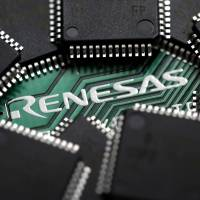 Re-restructure: A Renesas Electronics Corp. central processing unit board and microcontrollers are arranged for a photograph in Soka, Saitama Prefecture, in June 2012. | BLOOMBERG