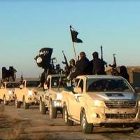 Road warriors: An image posted on a militant website Tuesday, shows a convoy of vehicles from the al-Qaida linked Islamic State of Iraq and the Levant in Iraq's Anbar province.   AP