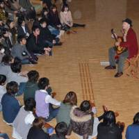 One man band: Steve Gardner gives an impromptu concert in  Tokyo on the night of the March 11, 2011, earthquake to calm stranded commuters. | COURTESY OF STEVE GARDNER