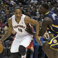 Cool off: Toronto's DeMar DeRozan tries to drive around Indiana's Lance Stephenson during the Raptors' 95-82 win on Wednesday. | AP