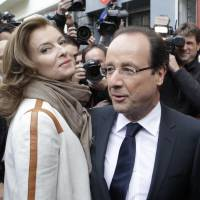 Split ticket: Then-Socialist Party presidential candidate Francois Hollande and his companion Valerie Trierweiler leave after voting in the second round of the presidential election in Tulle, France, in May 2012. | AP