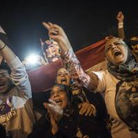 'New Egypt dawns' as voters overwhelmingly back new constitution