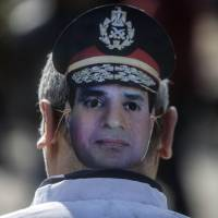 Muzzled Morsi makes second court appearance in Egypt