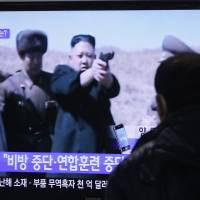 Chiller: A man at the Seoul Railway Station watches a TV news program showing North Korean leader Kim Jong Un on Thursday.   AP