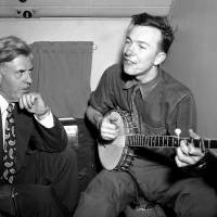 Soaring: Henry A. Wallace listens to Pete Seeger on a plane between Norfolk and Richmond, Virginia, in August 1948.   AP