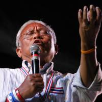 'Come and get us!': Anti-government protest leader Suthep Thaugsuban rallies supporters from a stage after a daylong march through the streets of central Bangkok on Tuesday. | AP