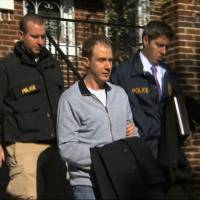 Self-inflicted: Ryan Loskarn, former chief of staff to Tennessee Sen. Lamar Alexander, is escorted from his Washington home by U.S. Postal Inspector police in a TV grab from Dec. 11. Loskarn has been found dead in Maryland, just weeks after the former staffer's arrest on child pornography charges. | AP