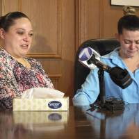 Lethal injunction?: Amber McGuire (left) recounts the execution of her father, Dennis McGuire, as her sister-in-law, Missie McGuire, cries at a news conference Friday in Dayton, Ohio, where they announced a planned lawsuit against the state over the unusually slow execution. | AP