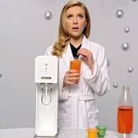 Trouble bubbles up: In this frame grab provided by SodaStream, actress Scarlett Johansson promotes the company's home soda maker in its Super Bowl commercial. | AP