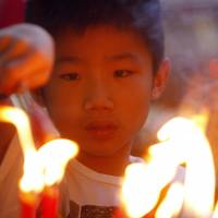 Burning ambition: An ethnic Chinese boy lights candles and joss sticks on Friday, the first day of the Chinese Lunar New Year, at a temple in Kuala Lumpur. | AP