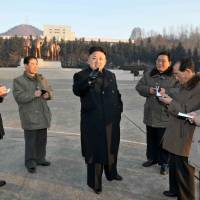Science for the people: This undated picture released by North Korea's official Korean Central News Agency on Wednesday shows North Korean leader Kim Jong-Un (center) inspecting the state academy of science in Pyongseong city in South Pyongan province. | AFP-JIJI