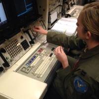 Launching controversy: A Minuteman 3 missile launch officer works at the console of a launch simulator used for training at the F. E. Warren Air Force Base in Wyoming on Jan. 9. | AP