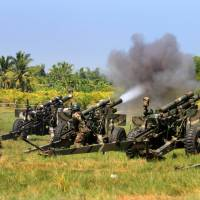 Outgoing: Philippine soldiers fire 105mm howitzer cannons toward the position of Muslim renegade factions rebels during a clash near Rajah Buayan, in Maguindanao province on the southern island of Minadanao, on Tuesday. | AFP-JIJI
