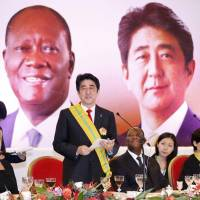 African interests: Prime Minister Shinzo Abe delivers a speech during a meeting with Western African heads of state on Friday in Abidjan. | KYODO
