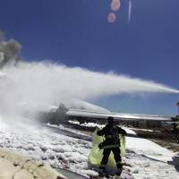 In harm's way: An image from the helmet-mounted video camera of a San Francisco fire battalion chief shows a firefighter covering the body of passenger Ye Meng Yuan at the scene of the Asiana Flight 214 crash at San Francisco International Airport on July 6, 2013. Yuan, who was alive following the crash, was later run over and killed by a fire truck. | AP