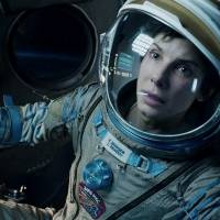 Watch this space: Sandra Bullock gazes into space in a scene from the film 'Gravity.' Alfonso Cuaron, the film's director, scooped the top prize at the 66th Directors Guild of America Awards on Saturday, giving him the edge over rivals in the home stretch to the Oscars. | AP
