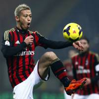 On target: Keisuke Honda controls the ball during AC Milan's 3-1 win over Spezia in the Italian Cup on Wednesday. | AP