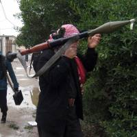 Packing: Gunmen patrol in Fallujah, 65 km west of Baghdad, on Saturday. Fighting between security forces and al-Qaida-linked militants in Iraq has killed scores of people over the past two weeks. | AP