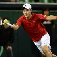 Pegged back: Go Soeda plays a return during his 6-4, 7-6 (7-2), 6-1 defeat to Canadian No. 1 Frank Dancevic on Friday. | AFP-JIJI
