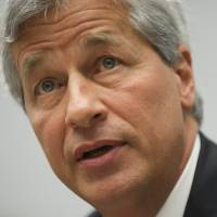 Piling on the digits: JPMorgan Chase Chairman and CEO Jamie Dimon testifies during a U.S. House Financial Services Committee hearing in Washington in June 2012. Dimon saw his pay nearly double to $20 million in 2013 despite the bank's record legal and regulatory costs, according to a filing Friday. | AFP-JIJI