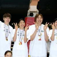 How sweet it is: JX-Eneos Sunflowers players celebrate the team's Empress' Cup title on Sunday, a 69-61 win over Toyota Motors Antelopes.   KAZ NAGATSUKA