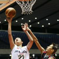 Inside effort: JX-Eneos Sunflowers post player Yuka Mamiya works close to the basket in the Empress Cup final against the Toyota Motors Antelopes on Sunday. | KYODO