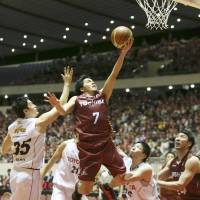 Staying aggressive: Toshiba guard Ryusei Shinoyama leaps into the air to take a layup against Toyota Motors during the All-Japan Championship final on Monday. | KYODO