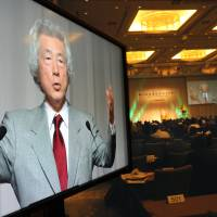 Taking a stand: Former Prime Minister Junichiro Koizumi speaks before corporate leaders Friday at a seminar at Palace Hotel Tokyo in Chiyoda Ward. | SATOKO KAWASAKI