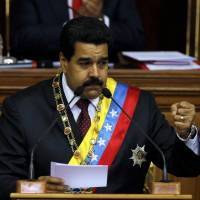 High drama: Venezuelan President Nicolas Maduro gives the annual state-of-the-nation address to the National Assembly in Caracas on Jan. 15. | AP