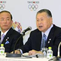 Games faces: Former Prime Minister Yoshiro Mori faces the media Friday in Tokyo after he was officially named the president of the organizing committee for the 2020 Olympics and Paralympics, as Toshiro Muto, the committee's CEO and a former vice finance minister, looks on. | KYODO