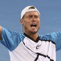 Happy new year: Lleyton Hewitt celebrates after beating Roger Federer 6-1, 4-6, 6-3 in the men's final of the Brisbane International on Sunday. | AP
