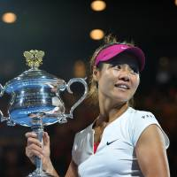 Third time's a charm: After reaching the finals twice before, Li Na captures her first Australian Open title on Saturday, beating Dominika Cibulkova of Slovakia 7-6 (7-3), 6-0. | AFP-JIJI