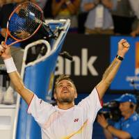 Magic moment: Stanislas Wawrinka celebrates after beating Rafael Nadal 6-3, 6-2, 3-6, 6-3 in the final of the Australian Open in Melbourne on Sunday night. | AFP-JIJI