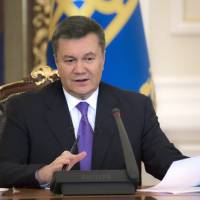 Time-honored practice: Ukrainian President Viktor Yanukovych holds a news conference in Kiev on Dec. 19. The embattled Yanukovych announced Thursday his is taking sick leave for acute respiratory illness and high fever as the country's political crisis continues without signs of resolution. There was no indication of how long he might be on leave. | AP