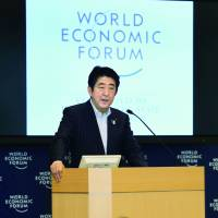 Prime Minister Shinzo Abe makes a speech at the WEF Japan Meeting last June in Tokyo. | KYODO