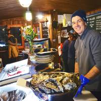 Warm welcome: James Gallagher  owns Ezo Seafoods, which is located in the après-ski hot spot of Momiji Street in Hirafu, Hokkaido. | ETHAN SALTER