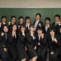 TFJ founder Yusuke Matsuda (back row, fourth from right) poses with 'TFJ fellow' hopefuls. | NATSUKI YASUDA