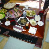 A typical spread for a family gathering. Sushi is one of the most popular cuisines for such meals. | MAKIKO ITOH