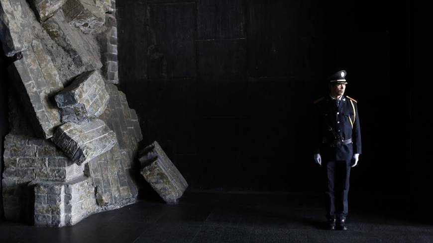 A security guard stands guard inside the Memorial Hall at the Nanjing Massacre Museum in Nanjing, Jiangsu Province. China wants to make World War II a key part of a trip by President Xi Jinping to Germany next month, much to Berlin's discomfort. | REUTERS