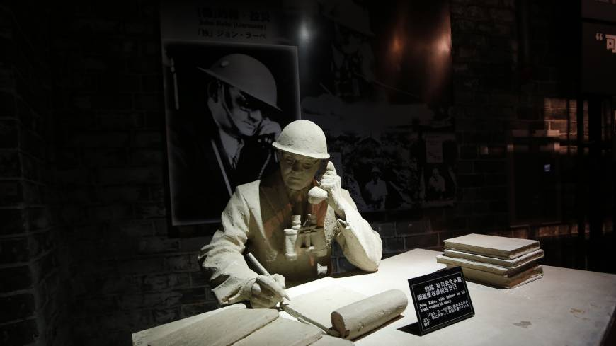 A model and a photograph of John Rabe, sometimes call 'China's Schindler,' are seen in a museum, during a reporting trip in Nanjing, Jiangsu province on Feb. 19, 2014. Rabe, a long-time resident of China from Germany, was head of the International Safety Zone in Nanjing during the December 1937 Nanjing Massacre and he is praised for having helped save the lives of more than 200,000 people who took refuge in the zone.